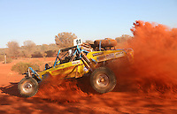 Australia's Finke Desert Race is a legendary event, testing man and machine. Since 1976 on the Queen's birthday weekend (a three day weekend in the middle of June) the 'there and back' challenge from Alice Springs to the Finke River (believed to be the oldest river in the world at 350 millions years). Started by a group of local die-hard motorbike riders, now over 500 Australian competitors, race a 284 mile course on some of the world's toughest terrains and harshest climates. King of the Desert, is awarded to fastest outright time. Originally a bikes only affair, now cars and off-road buggies join the madness. 2008 Kings of the Desert for Cars are Dave Fellows, Andrew Kittle and Jason Adami in record time of 3hrs  39mins and repeating winner for Bikes: Ben Grabham.                                                  PICTURED - Jun 09, 2008 - Alice Springs, Northern Territory, Australia - Buggy cars in the race..  (Credit Image: