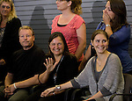 Edda Knox, center, waves at a group of supporters while Amanda Knox, right, and father, Kurt, left, smile during a news conference held  at the Seattle-Tacoma International Airport near Seattle, Washington on October 4, 2011. Knox arrived in the United States after departing Rome's Leonardo da Vinci airport,. Knox's life turned around dramatically Monday when an Italian appeals court threw out her conviction in the sexual assault and fatal stabbing of her British roommate.  ©2011. Jim Bryant Photo. All Rights Reserved.
