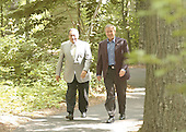 United States President George W. Bush and President Hosni Mubarak of Egypt walk through the woods of Camp David, Maryland  on the way to address the media and answer reporters questions on the Middle East on Saturday, June 8, 2002..Credit: Greg E. Mathieson - Pool via CNP
