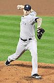New York Yankees pitcher A.J. Burnett (34) works in the second inning  where he was tagged for six runs against the Baltimore Orioles at Oriole Park at Camden Yards in Baltimore, MD on Friday, August 26, 2011.  .Credit: Ron Sachs / CNP.(RESTRICTION: NO New York or New Jersey Newspapers or newspapers within a 75 mile radius of New York City)