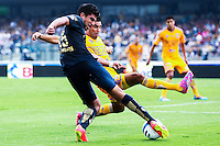 Pumas player Eduardo Herrera (15) fights for the ball with Tigres defense player José Rivas (24) during their match between Pumas VS Tigres both teams were tied at two goals. Photo by Miguel Angel Pantaleon/VIEWpress