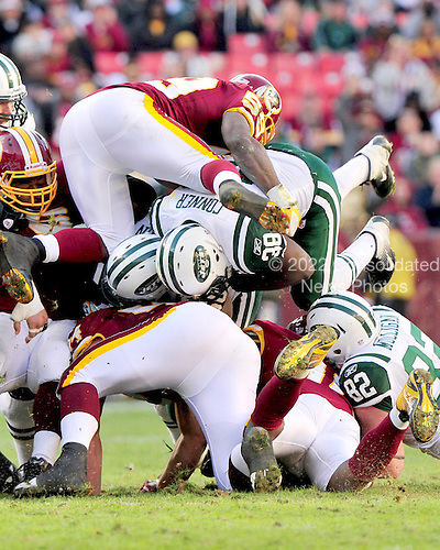New York Jets fullback John Conner (38) picks-up a critical first down in the third quarter against the Washington Redskins at FedEx Field in Landover, Maryland on Sunday, December 4, 2011.  Redskins linebacker London Fletcher goes up in the air to try to stop him.  The Jets won the game 34 - 19.  .Credit: Ron Sachs / CNP.(RESTRICTION: NO New York or New Jersey Newspapers or newspapers within a 75 mile radius of New York City)