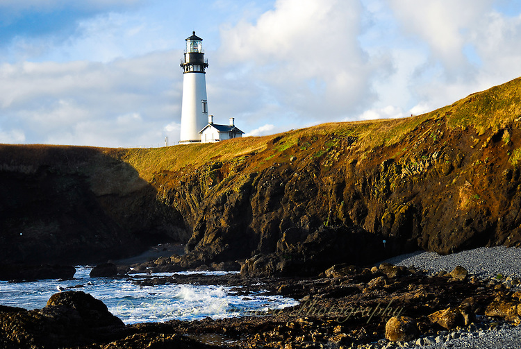 &quot;YAQUINA HEAD&quot;<br /> <br /> Yaquina Head lighthouse stands in cloudy blue skies watching over the rocky Oregon Coast
