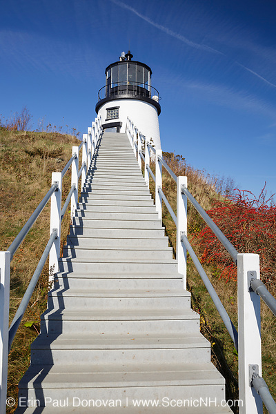 Owls Head Light, established in 1825, at the entrance of Rockland Harbor in the town of Owls Head, Maine. This lighthouse is part of Owls Head State Park.