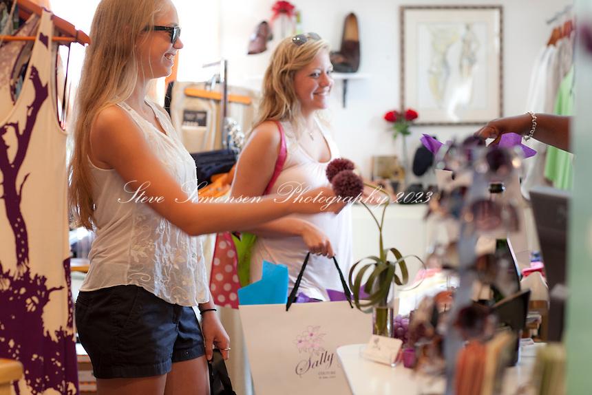 Girls shopping at Sally's Boutique<br /> Cruz Bay<br /> St. John, U.S. Virgin Islands