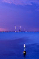 Lightning strike over Rottnest with the Cottesloe Pylon.