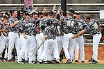 21 May 2016: Wake Forest's Gavin Sheets (24) is mobbed by teammates after hitting a home run. The Wake Forest University Demon Deacons played the University of Louisville Cardinals in an NCAA Division I Men's baseball game at David F. Couch Ballpark in Winston-Salem, North Carolina. Louisville won the game 9-4.