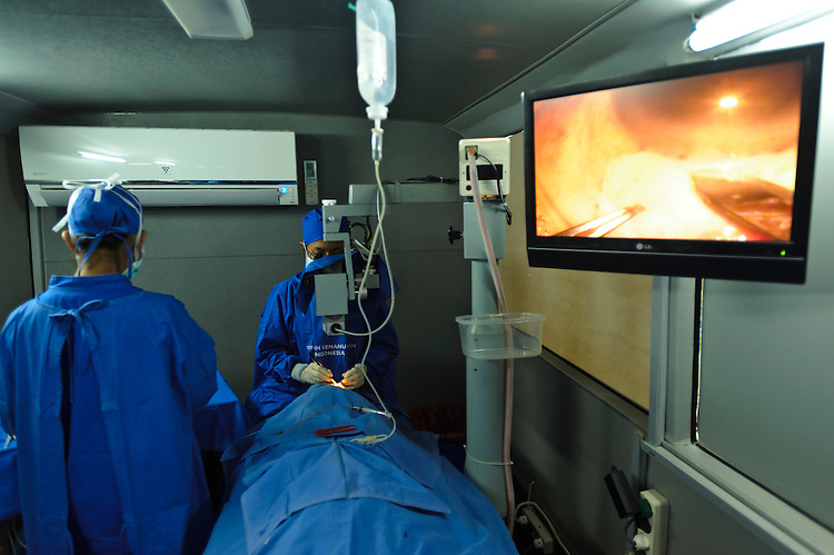 A patient undergoing cataract surgery in a mobile clinic, Bali, Indonesia.