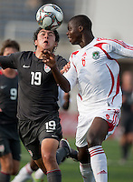 Victor Chavez battles against Pete Mselema. US Men's National Team Under 17 defeated Malawi 1-0 in the second game of the FIFA 2009 Under-17 World Cup at Sani Abacha Stadium in Kano, Nigeria on October 29, 2009.