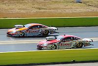 Sept. 24, 2011; Ennis, TX, USA: NHRA pro stock driver Greg Anderson (near) races alongside Jason Line during qualifying for the Fall Nationals at the Texas Motorplex. Mandatory Credit: Mark J. Rebilas-