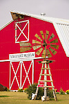 A Baker Monitor windmill greats visitors to the big red barn housing the Farm & Ranch Museum along Rt. 66 in Elk City, Oklahoma.