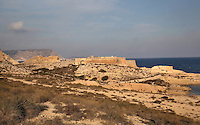 The San Ramon Castle, or Castillo de San Ramon, built in 1764 with a battery designed by Jose Crame with 4 guns to guard the coastline between the Cerrico Romero and Cala de San Pedro from attacks by Barbary pirates, with the Playazo de Rodalquilar in the foreground, in the Cabo de Gata-Nijar Natural Park, Almeria, Andalusia, Southern Spain. The park includes the Sierra del Cabo de Gata mountain range, volcanic rock landscapes, islands, coastline and coral reefs and has the only warm desert climate in Europe. The park was listed as a UNESCO Biosphere Reserve in 1997 and a Specially Protected Area of Mediterranean Importance in 2001. Picture by Manuel Cohen
