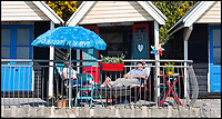 BNPS.co.uk (01202 558833)<br /> Pic: PhilYeomans/BNPS<br /> <br /> Home from home local couple at their beach hut in Bournemouth.<br /> <br /> Sizzling Sunday - Holidaymakers make the most of the first hot weekend of the year on Bmth beach today.
