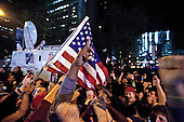 A crowd cheers and chants in excitement at the corner of Vesey St. and Liberty St. next to Ground Zero after hearing that Osama Bin Laden is dead. Bin Laden planned the attacks, September 11, 2001 and has been hunted by American forces in the years since. He was killed by a raid in Abbottabad, Pakistan near the country's capital. The Freedom Tower, the skyscraper being built where the World Trade Center towers once stood, is now 60 stories tall and was lit up and visible from the street. Eventually the Freedom Tower will be the tallest building in the country..Mandatory Credit: Randall Clinton - USMC via CNP