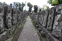 """Jizo statues at Jomyoin temple, Yanaka, Tokyo, Japan, April 20, 2012. Yanaka is part of Tokyo's """"shitamachi"""" historic working class wards. Recently it has become popular with Japanese and foreign tourists for its many temples, shops, restaurants and relaxed atmosphere."""