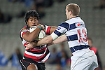 Ahsee Tuala tries to fight off the tackle of Hadleigh Parkes. ITM Cup Round 7 rugby game between Auckland and Counties Manukau, played at Eden Park, Auckland on Thursday August 11th..Auckland won 25 - 22.
