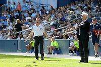 Kansas City head coach Peter Vermes and Red Bull Head coach Hans Backe giving instructions from the side line...Sporting Kansas City defeated New York Red Bulls 2-0 at LIVESTRONG Sporting Park, Kansas City, Kansas.