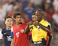 Yellow Card: Costa Rican goalkeeper Patrick Pemberton (18) from Courtney Campbell. In CONCACAF Gold Cup Group Stage, the U.S. Men's National Team (USMNT) (blue/white) defeated Costa Rica (red/blue), 1-0, at Rentschler Field, East Hartford, CT on July 16, 2013.