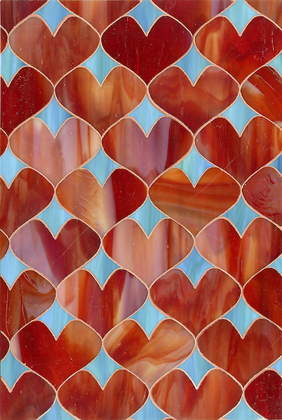 Hearts, a glass waterjet mosaic  shown in Garnet and George, is part of the Erin Adams Collection for New Ravenna Mosaics.