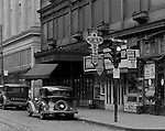 Pittsburgh PA:  View of stores along Diamond Street near the corner of Wood Street - 1935.  Nearby stores include; Diamond Key Store, Diamond Market, John M Roberts and Sons, Hendel Building and Diamond Pawn Shop