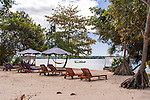 A number of lounge chairs and day beds line the beach front at Siladen Resort and Spa, on Siladen Island in the Bunaken National Park off North Sulawesi, Indonesia.