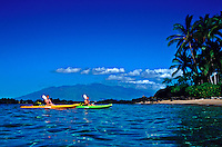 Couple (MR) is paddling back in from a reef dive along the Maui coastline. The West Maui Mountains can be seen in the background.