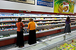 Iraqi women shop at a supermarket in Duhok, Iraq. Although international tourism is almost non-existent, Kurdistan is a major destination for Iraqis seeking to escape the violence that has plagued the country follwing the US invasion in 2003...Stability and security prevail in postwar Iraqi Kurdistan as Iraqi tourists, many of them from Baghdad, flock to the northern cities and their amusement parks and national parks to escape violence and sectarian strife in the central and southern regions of the country.