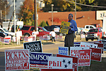 District 1 candidate Bill Plunk holds a sign outside the old National Guard Armory in Oxford, Miss. on Tuesday, November 8, 2011. Mississippians go to the polls today for state and local elections, as well as referendums including the so-called Personhood Amendment.