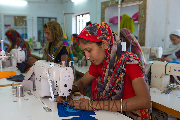 Indian women sewing textiles at Dastkar women's craft co-operative, the Ranthambore Artisan Project, in Rajasthan, India