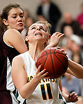 Waterbury, CT- 30, December 2010-123010CM13 Holy Cross' Brianna Ferraro looks for an open shot as Torrington's Taylor Christiano defends Thursday night in Waterbury. Holy Cross defeated Torrington, 50-44 to remain undefeated on the season. Christopher Massa Republican-American