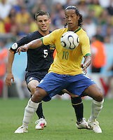 Brazilian midfielder (10) Ronaldinho takes control of the ball in front of Australian midfielder (5) Jason Culina. Brazil defeated Australia 2-0 in their FIFA World Cup Group F match at the FIFA World Cup Stadium, Munich, Germany, June 18, 2006.