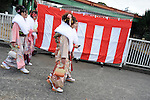 Kimono-clad 20-year-old Japanese women make their way to a ceremony held for Coming-of-Age Day in Tokyo, Japan. While Japanese women can marry as early as 16 years of age and men at 18, neither is considered to reach adulthood until they reach 20, when they can also legally begin to smoke, drink and vote.ey can also legally begin to smoke, drink and vote.