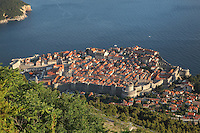 The medieval walled city, with the defensive walls and the Minceta Tower, and the old harbour on the left, Dubrovnik, Croatia. The city developed as an important port in the 15th and 16th centuries and has had a multicultural history, allied to the Romans, Ostrogoths, Byzantines, Ancona, Hungary and the Ottomans. In 1979 the city was listed as a UNESCO World Heritage Site. Picture by Manuel Cohen