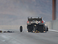 Oct 29, 2016; Las Vegas, NV, USA; NHRA funny car driver Jon Capps crashes into the wall after losing his steering during qualifying for the Toyota Nationals at The Strip at Las Vegas Motor Speedway. Capps was uninjured in the incident. Mandatory Credit: Mark J. Rebilas-USA TODAY Sports