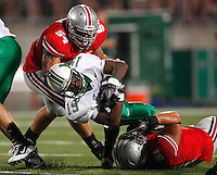 Ohio State defensive lineman John Simon (54) and Ohio State linebacker Ross Homan (51) tackle Marshall running back Andre Booker (19) during the third quarter of the NCAA football game at Ohio Stadium on Thursday, September 2, 2010. (Photo by Jonathan Quilter)