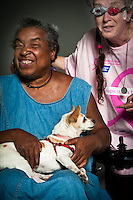 Jackie Mahone-Tyson holds Lily, a eight-year-old chihuahua she adopted from the Sacramento city animal shelter. Pictured with Karen Mahone-Smith.