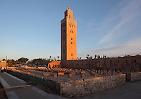 Koutoubia mosque and grounds, Medina, Marrakech, Morocco. The mosque was completed in the reign of the Almohad Caliph Yaqub al-Mansur, 1184-1199. The minaret stands 77m tall and is built of sandstone bricks, topped with copper orbs. It is the largest mosque in Marrakech. Picture by Manuel Cohen
