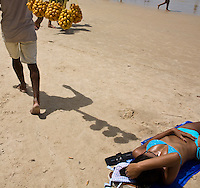 Street vendor selling fruits at the beach.