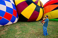 Hot air balloons capture spectator fascination at the 2012 Carolina Balloon Festival, held each October at the Statesville Regional Airport north of Charlotte. The annual festival is part of a fundraiser for the National Balloon Rally Charities, a 501(c)(3) charitable organization.