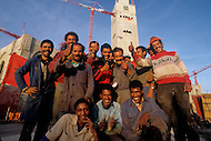 March 5, 1989, Casablanca, Morocco. Group of workers in front of the construction site of the Hassan II Mosque. The mosque was completed in 1993.