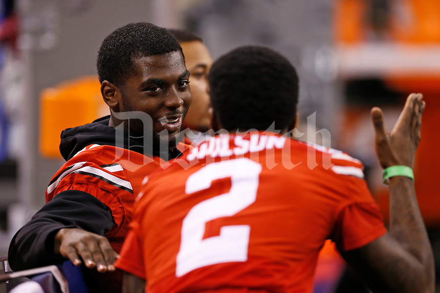 Ohio State Buckeyes quarterback J.T. Barrett (16) talks to running back Dontre Wilson (2) on the bench prior to the Big Ten Championship game against the Wisconsin Badgers at Lucas Oil Stadium in Indianapolis on Dec. 6, 2014. Barrett didn't play in the game due to a broken ankle. (Adam Cairns / The Columbus Dispatch)