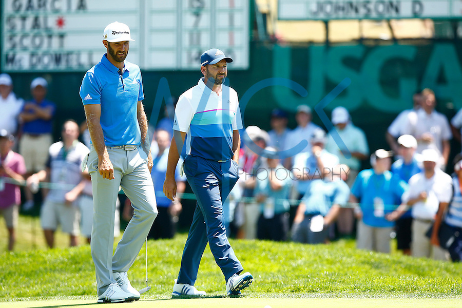 Dustin Johnson and Sergio Garcia walk to the 16th green during the 2016 U.S. Open in Oakmont, Pennsylvania on June 17, 2016. (Photo by Jared Wickerham / DKPS)