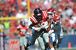 Ole Miss' Donte Moncrief (12) bobbles a pass as Arkansas cornerback Tevin Mitchel (8) and Arkansas safety Eric Bennett (14) defend at Vaught-Hemingway Stadium in Oxford, Miss. on Saturday, October 22, 2011. The pass was incomplete..