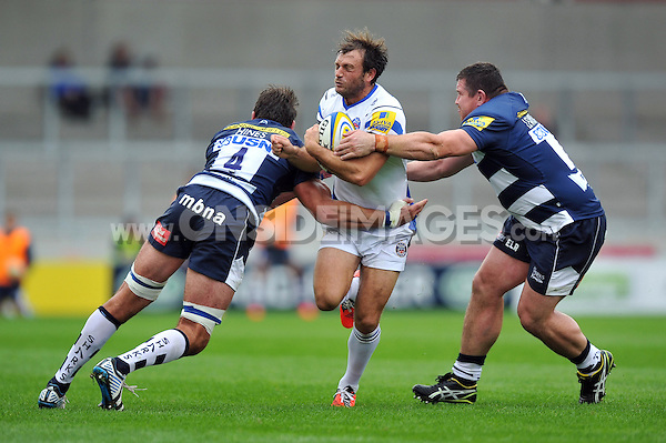 Luke Arscott is double-tackled by Nathan Hines and Eifion Lewis-Roberts. Aviva Premiership match, between Sale Sharks and Bath Rugby on September 6, 2014 at the AJ Bell Stadium in Manchester, England. Photo by: Patrick Khachfe / Onside Images