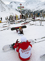"Switzerland. Canton Valais. Russian snowboarders in Verbier at  "" La Chaux"" ( 2260 meters ). Verbier is a village located in the municipality of Bagnes in the Val de Bagnes. Verbier is one of the largest holiday resort and ski areas in the Swiss Alps. Russian tourists. Indication signs. 3.01.2012 © 2012 Didier Ruef"