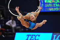 September 8, 2009; Mie, Japan;  Evgeniya Kanaeva of Russia split leaps with hoop during qualification round at 2009 World Championships Mie. Evgeniya became world champion 3-days later at Mie and was the 2008 gold individual medalist in rhythmic gymnastics at the Beijing Olympics. Photo by Tom Theobald .