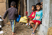 Monika (7, in red) and Aastha Baniya (6, in blue) sit with their cousins in their temporary home in Chautara, Sindhupalchowk, Nepal on 29 June 2015. The three girls lost their mother during the April 25th earthquake that completely levelled their house. Aastha was buried under the rubble together with her mother but Aastha survived. As their father Ratna Baniya (28) cannot care for the children on his own, SOS Childrens Villages has since been supporting the grandmother with financial and social support so that she can manage to raise the children comfortably and ensure that they will all be schooled. Photo by Suzanne Lee for SOS Children's Villages