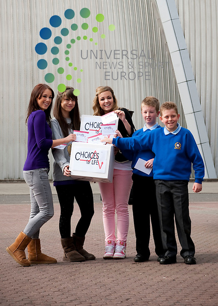 From left- Daizy Agnew, Pheobe Brown and Jess Stickley of 'Girls Can't Catch with Jack Hearton and Scott Carey (both 11). Around 7,000 P7 pupils from across Strathclyde will take part in today's event which, through a live entertainment programme using music and drama, aims to provide young people with information on substance misuse. The 'Choices for life' event is a major community safety programme organised by the Scottish Crime and Drug Enforcement Agency, with support of Scotland's Police forces. The children experienced a day of performances, ranging from music acts to plays...SECC, Finneston Quay, Scotland. Picture: Euan Anderson/Universal News And Sport (Scotland) 4th May 2010.