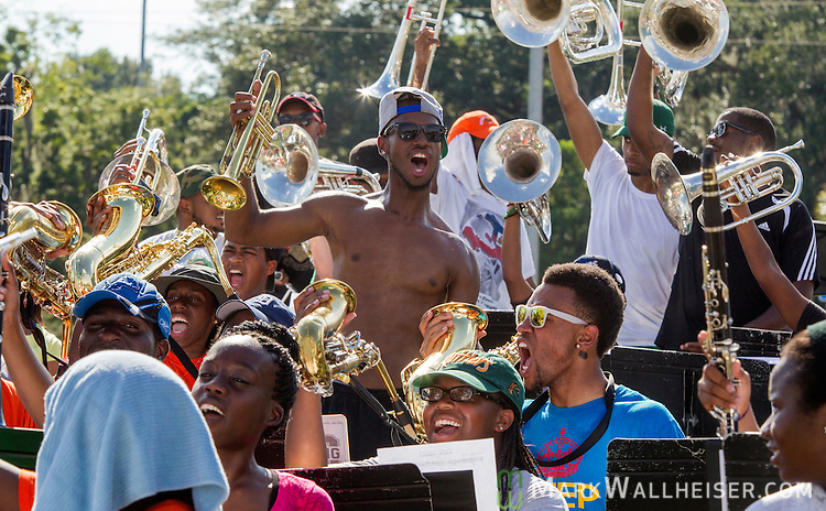 TALLAHASSEE, FL - SEPTEMBER 5, 2013:   <br /> Chavez Caley, center, a junior from Ft. Lauderdale, FL, goes through a cheer during the FAMU Marching 100 band practice on the Florida A&amp;M University campus.