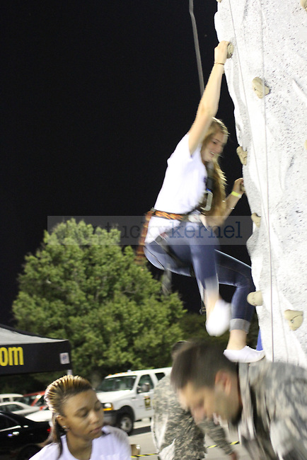 A student climbs a rock wall at Campus Ruckus at Commonwealth parking lot on Saturday, August 18, 2012. Photo by Tessa Lighty | Staff